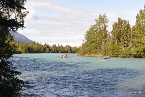 Fishermen drifting down the river